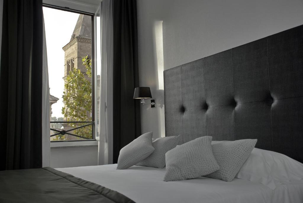 מיטה או מיטות בחדר ב-A Trastevere da M.E.