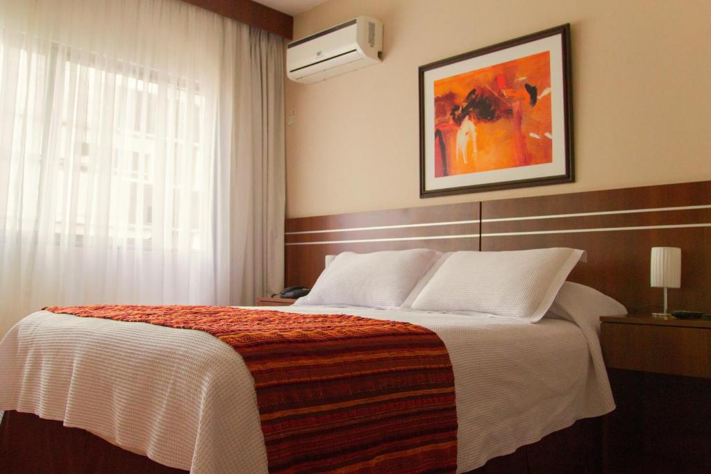 מיטה או מיטות בחדר ב-Hotel America