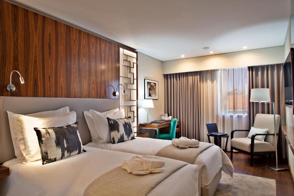 Cama ou camas em um quarto em TURIM Saldanha Hotel
