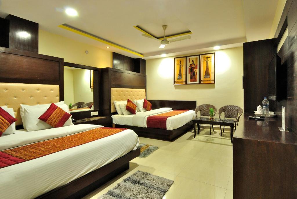 Cama ou camas em um quarto em Hotel Shelton