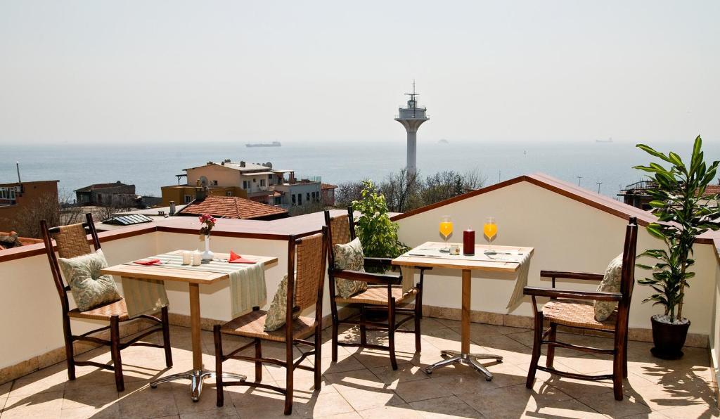 Un restaurant u otro lugar para comer en Hotel Sphendon