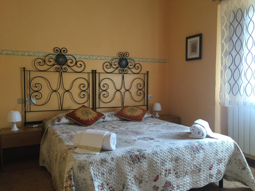 Cama ou camas em um quarto em Hotel Aline