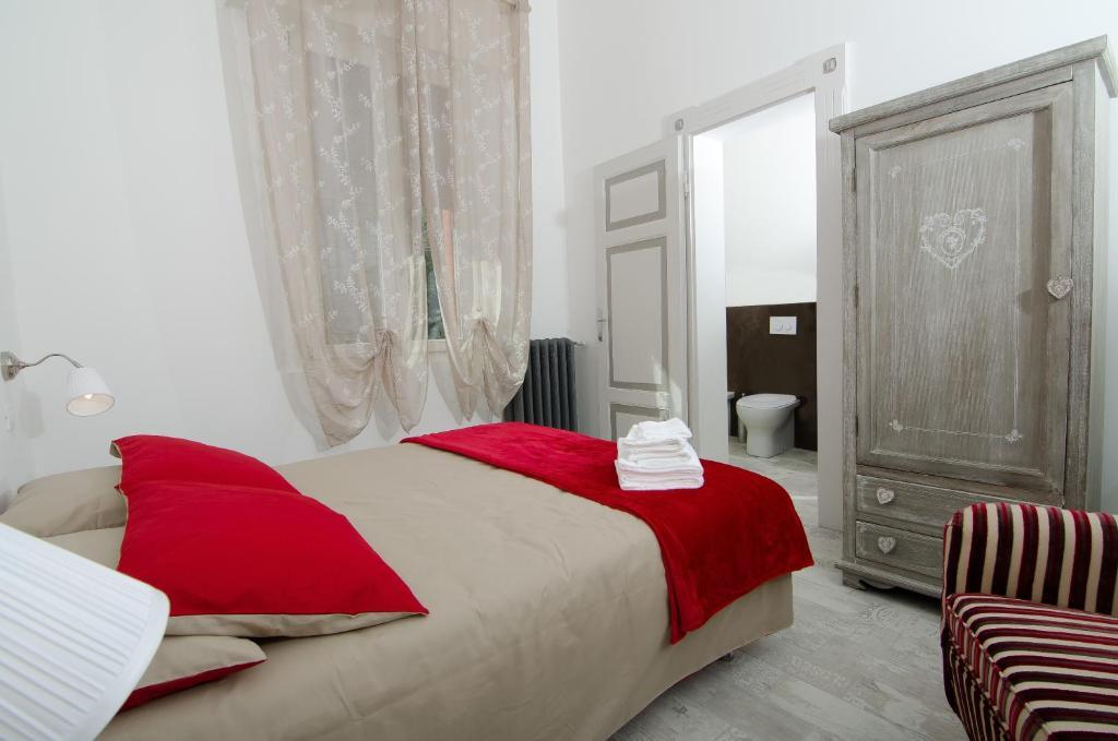 Cama ou camas em um quarto em A Casa di Lu Na