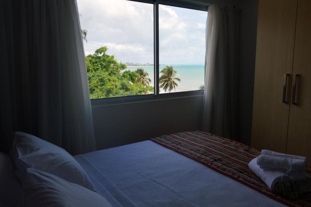 Cama ou camas em um quarto em Val Atlantic Hotel