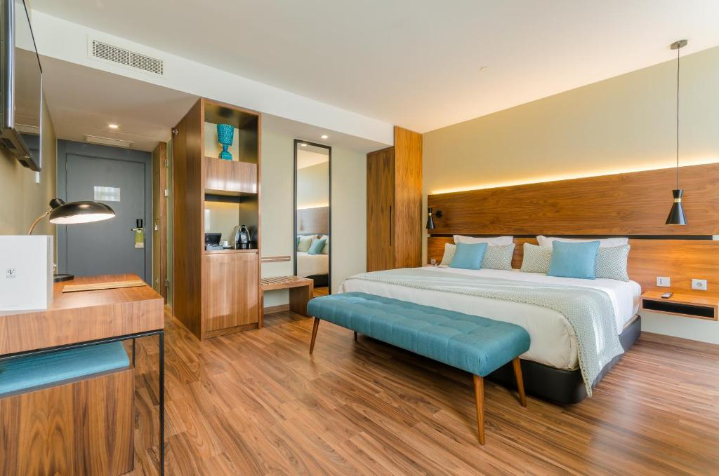 Cama ou camas em um quarto em Vincci Liberdade