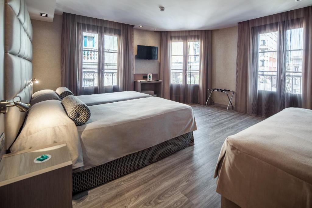 מיטה או מיטות בחדר ב-Hotel Suizo