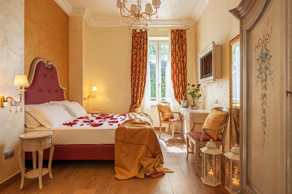 Cama ou camas em um quarto em Relais Empire