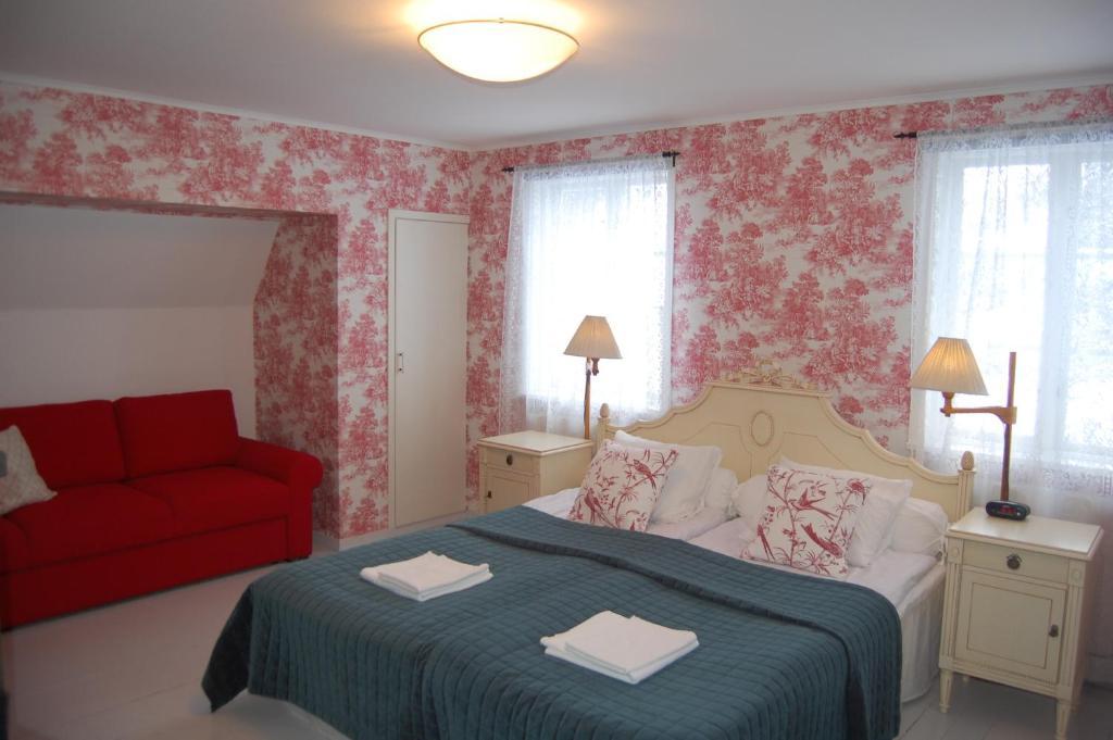 מיטה או מיטות בחדר ב-STF Vickleby Bo Pensionat