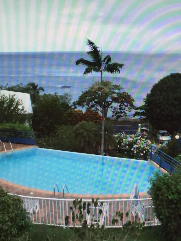 R sidence vue mer avec piscine au c le carbet martinique for Bungalow avec piscine martinique