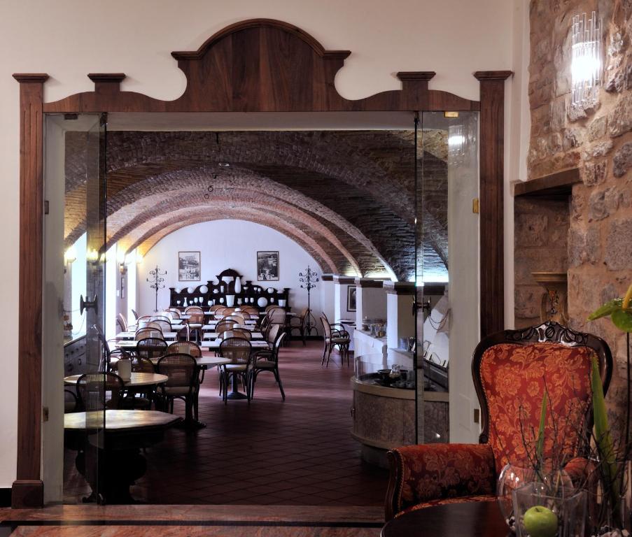 Um restaurante ou outro lugar para comer em Hotel San Marco