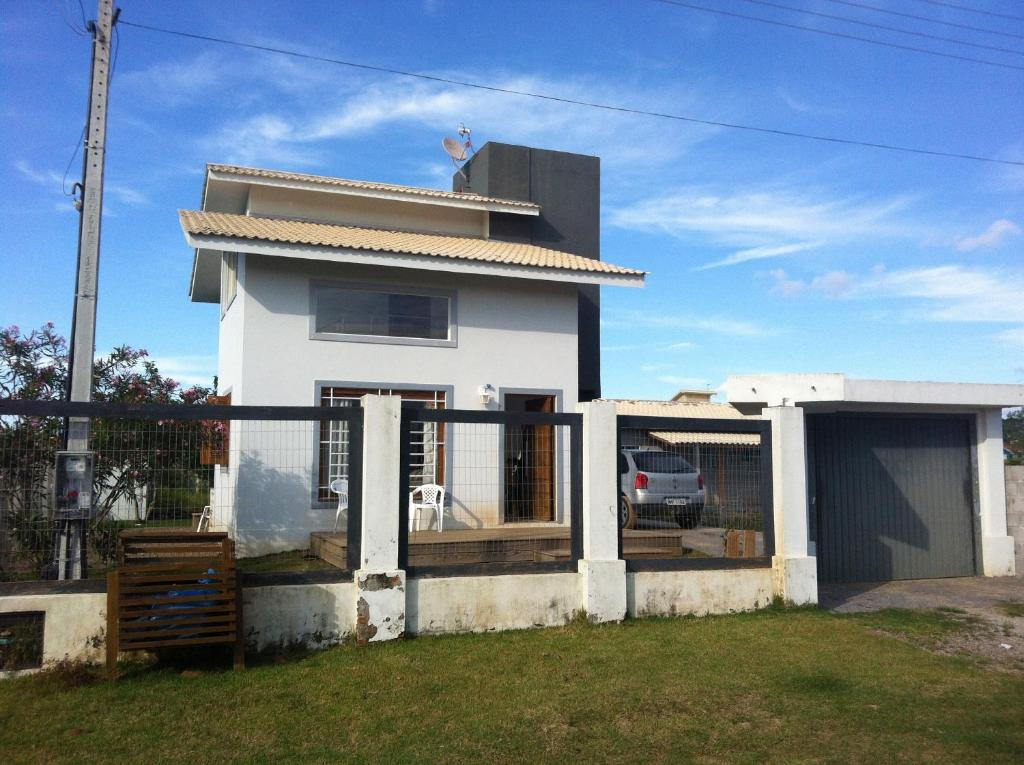 Casa de temporada casa lagoa de ibiraquera for Booking casas