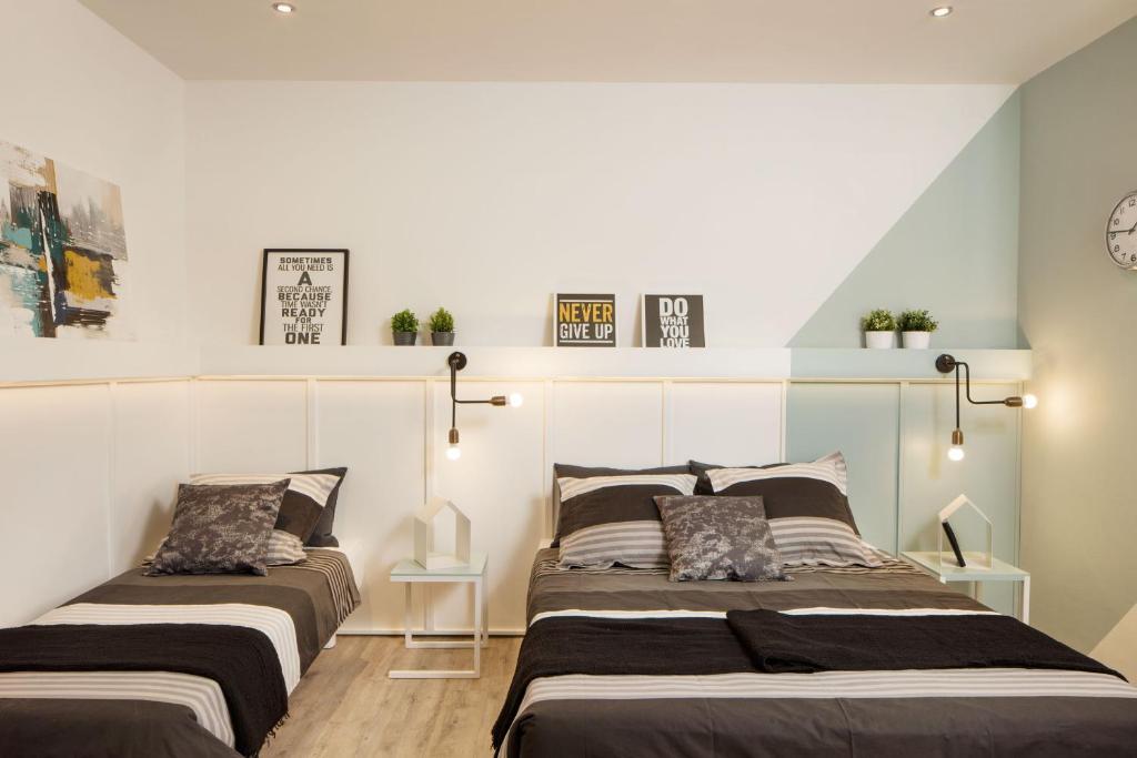 Cama ou camas em um quarto em Well.B