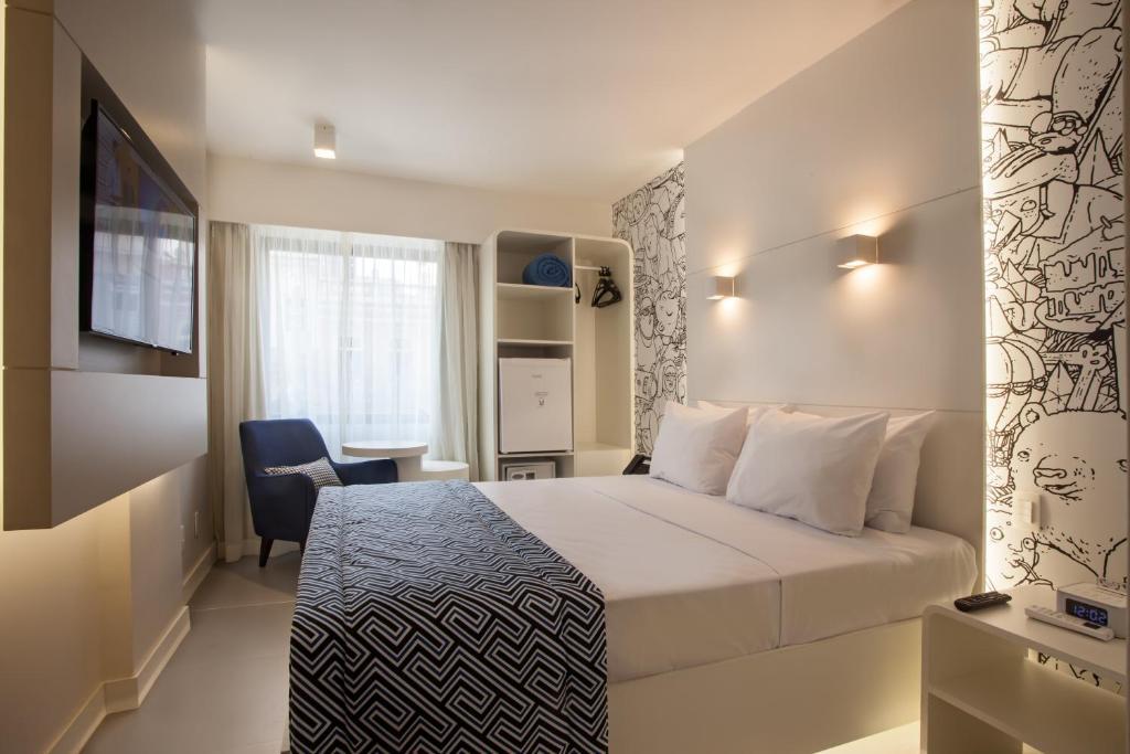 Cama ou camas em um quarto em Ibis Styles RJ Botafogo