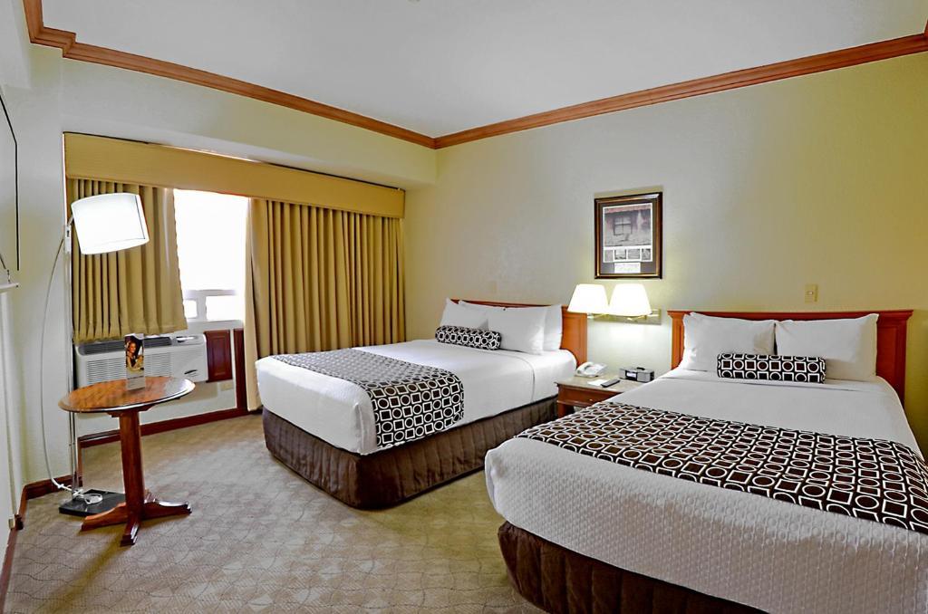 מיטה או מיטות בחדר ב-Hotel Las Americas