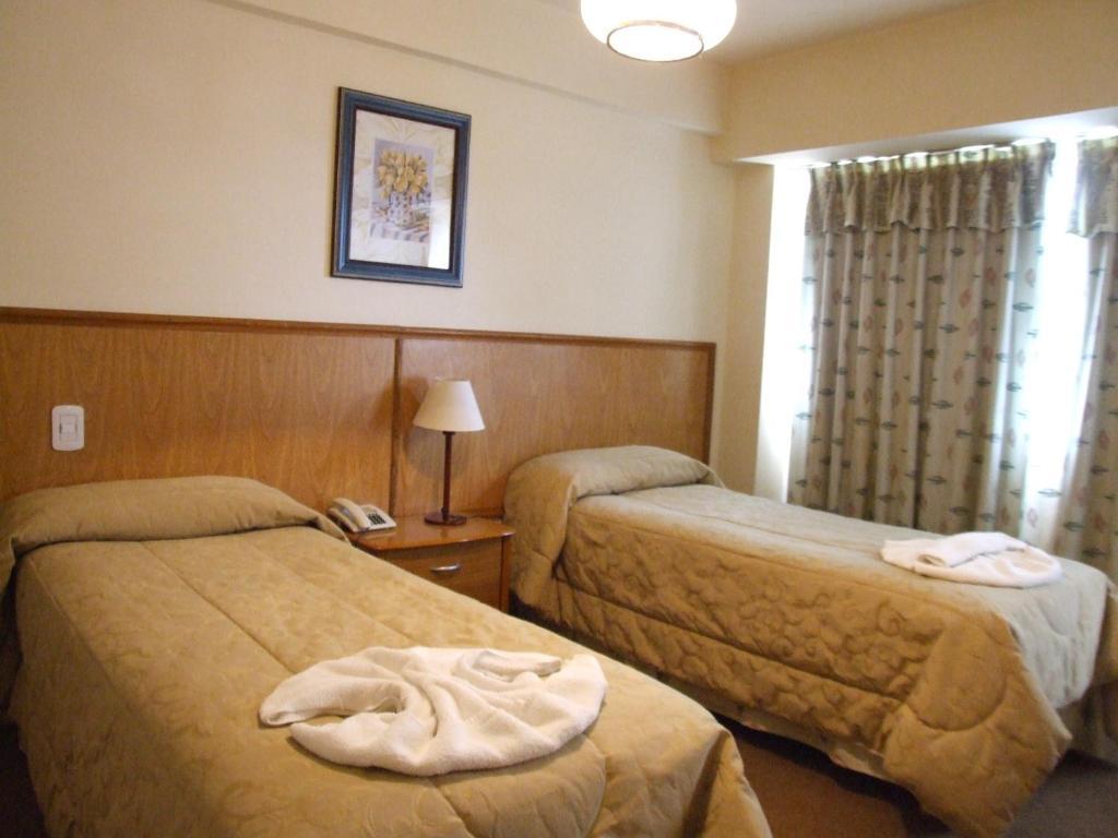 Una cama o camas en una habitación de Hotel Internacional