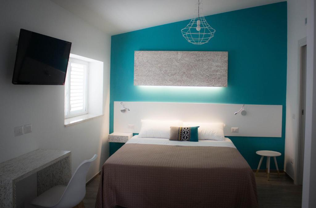 מיטה או מיטות בחדר ב-I MURETTI A SECCO B&B