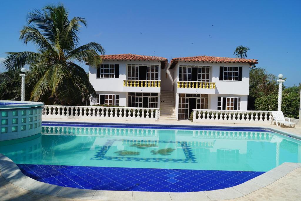 <div data-et-view=NAFQCDCcdXDPdFO:1</div Condominio Punta Bolivar