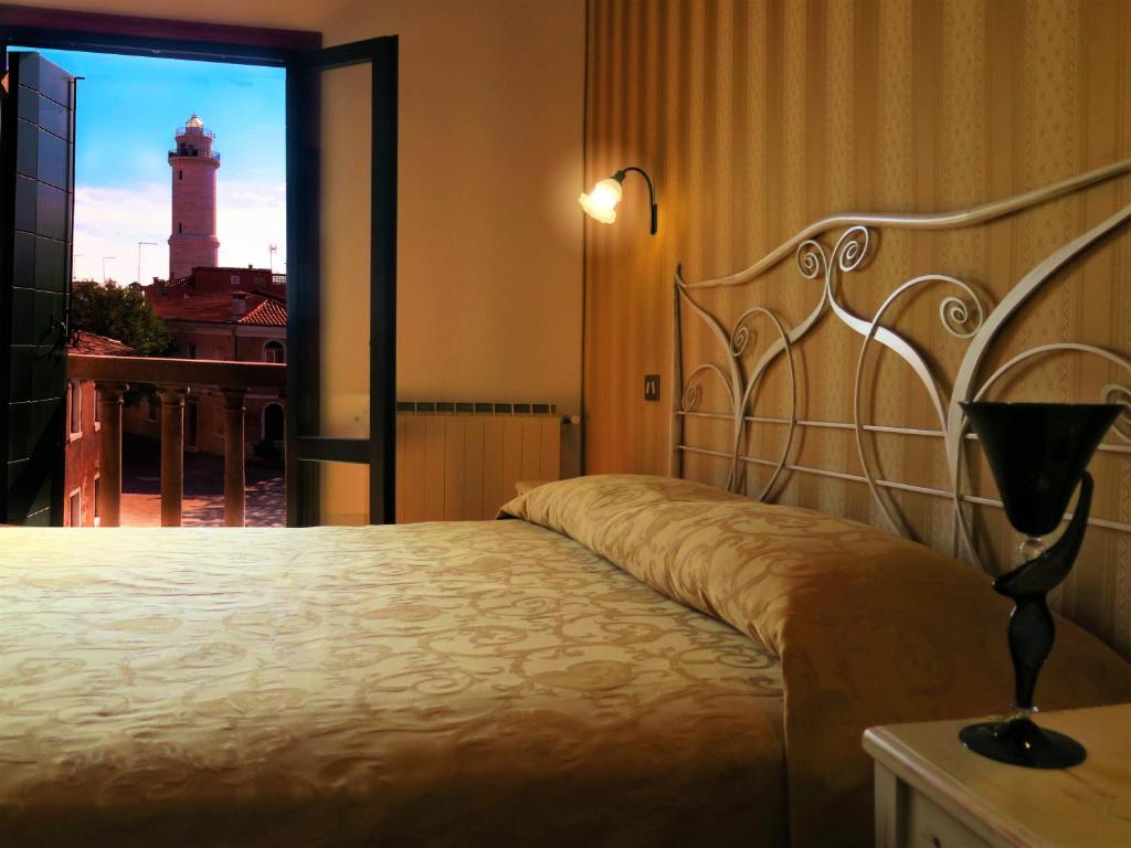 Una cama o camas en una habitación de Al Soffiador