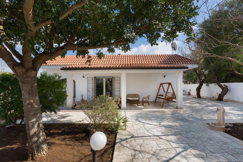 Villa angel bay italia punta prosciutto - Ville con giardino foto ...