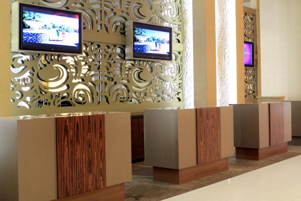 Una televisión o centro de entretenimiento en Elara by Hilton Grand Vacations - Center Strip