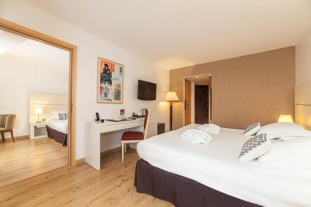 Quarto do Hotel Montaigne & Spa