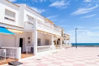 Tot un Mon-Beachfront House