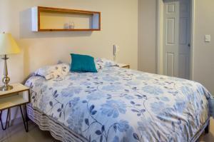 Cama ou camas em um quarto em Amplio condominio de lujo cerca de la playa