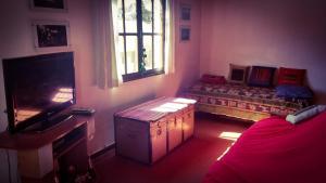 Una televisión o centro de entretenimiento en Departamento Centrico en Tilcara