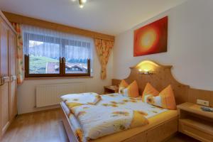 Giường trong phòng chung tại Haus Berthold