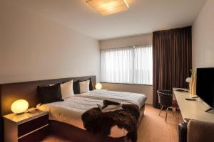 Cama ou camas em um quarto em Htel Serviced Apartments Amsterdam