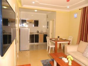 مطبخ أو مطبخ صغير في وناسة للشقق الفندقية