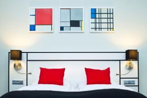 מיטה או מיטות בחדר ב-Hapimag Resort Amsterdam
