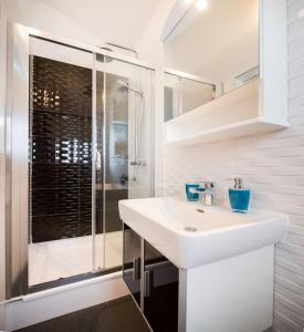 Un baño de Pavao Apartments