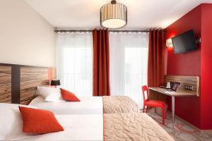Cama ou camas em um quarto em Quality Suites Lyon Confluence