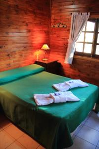 Una cama o camas en una habitación de Complejo villa elena