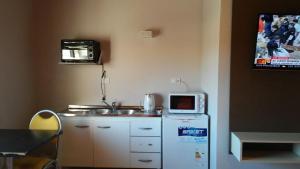 Una cocina o kitchenette en Aparts Piscu Yaco Almendros