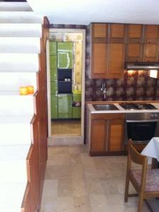 A cozinha ou cozinha compacta de Apartment Blaise-Old Town