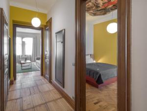 מיטה או מיטות בחדר ב-The Art House