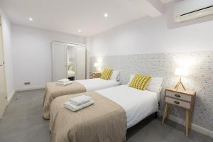 Cama ou camas em um quarto em Weflating Park Güell