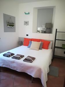 Cama ou camas em um quarto em L'Angolo di Niki