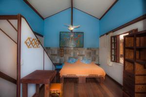 מיטה או מיטות בחדר ב-Shanti House Apart