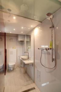 Um banheiro em Romeoapartment 1160