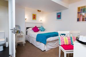 Cama ou camas em um quarto em The Pods at Nell Gwynn