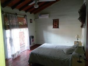 Una cama o camas en una habitación de Vacacion Serrana