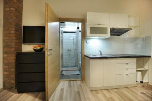 A cozinha ou cozinha compacta de Apartmány Kukučín
