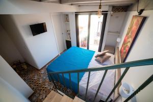 Una cama o camas en una habitación de Le Terme Romane Apartments
