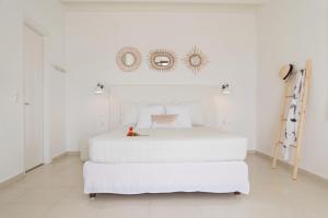 מיטה או מיטות בחדר ב-Rafaela Apartments