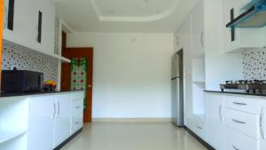 Una cocina o kitchenette en Blobb Serviced Aparments