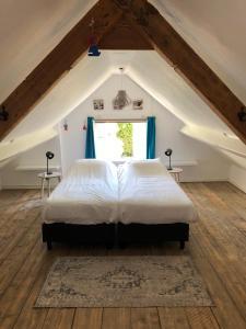 Una cama o camas en una habitación de Hogezoom 133