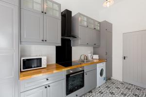 مطبخ أو مطبخ صغير في The Vintage Apartment